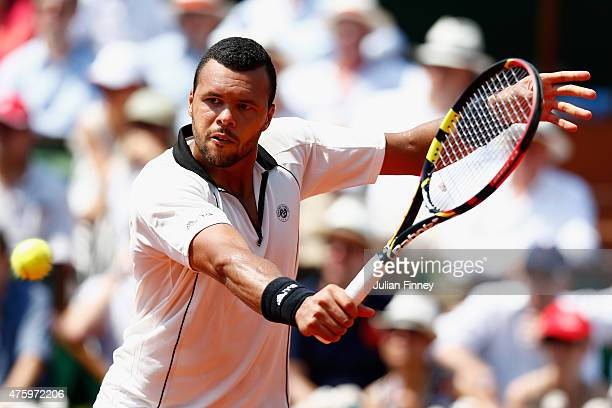 JoWilfried Tsonga of France plays a backhand in his Men's Semi Final match against Stanislas Wawrinka of Switzerland on day thirteen of the 2015...