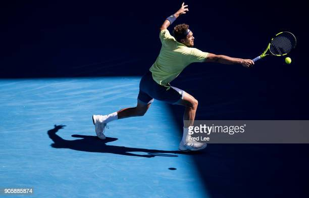 JoWilfried Tsonga of France plays a backhand in his second round match against Denis Shapovalov of Canada on day three of the 2018 Australian Open at...