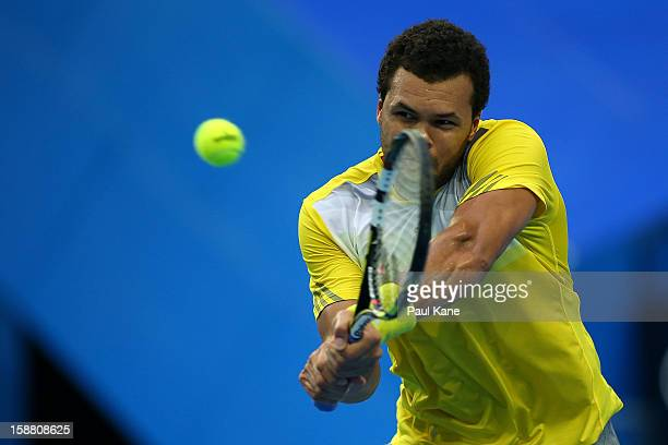 JoWilfried Tsonga of France plays a backhand in his singles match against Fernando Verdasco of Spain during day two of the Hopman Cup at Perth Arena...