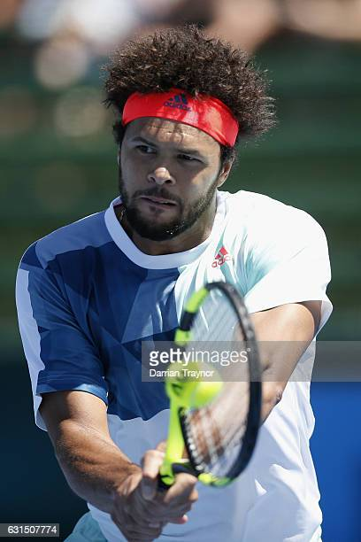 Jo-Wilfried Tsonga of France plays a backhand shot in his match against Borna Coric of Croatia during day three of the 2017 Priceline Pharmacy...