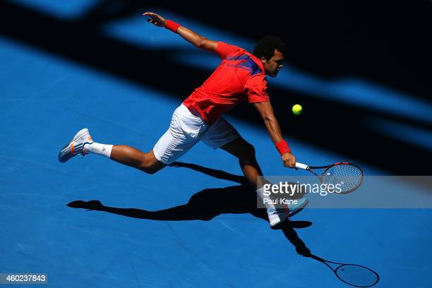 JoWilfried Tsonga of France plays a backhand to Daniel MunozDe La Nava of Spain in the men's singles match during day seven of the Hopman Cup at...