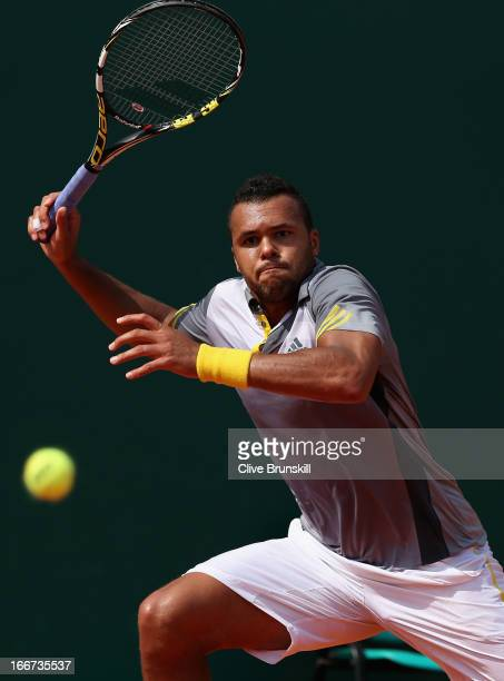 JoWilfried Tsonga of France plays a forehand against Nikolay Davydenko of Russia in their second round match during day three of the ATP Monte Carlo...
