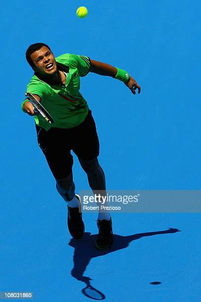 Jo-Wilfried Tsonga of France plays a forehand during his match against Jurgen Melzer of Austria during day three of the AAMI Classic at Kooyong on...