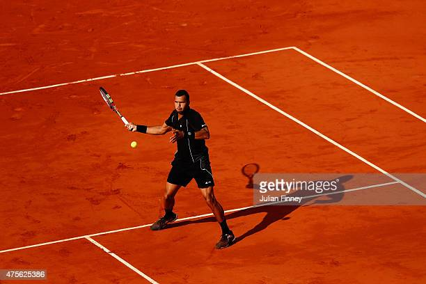 JoWilfried Tsonga of France plays a forehand during his Men's quarter final match against Kei Nishikori of Japan on day of the 2015 French Open at...