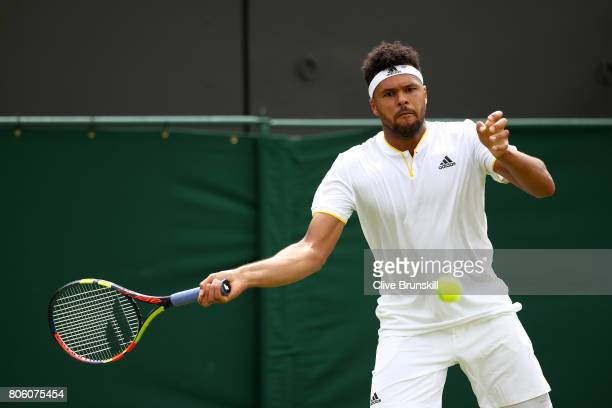 JoWilfried Tsonga of France plays a forehand during the Gentlemen's Singles first round match against Cameron Norrie of Great Britain on day one of...