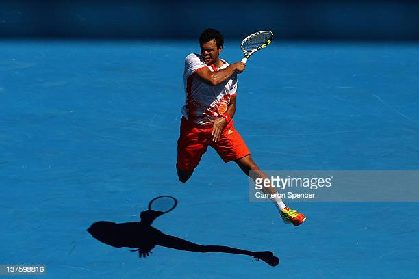 JoWilfried Tsonga of France plays a forehand in his fourth round match against Kei Nishikori of Japan during day eight of the 2012 Australian Open at...