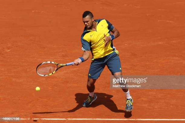 JoWilfried Tsonga of France plays a forehand in his Men's Singles match against Jarkko Nieminen of Finland during day four of the French Open at...