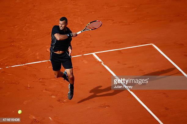 Jo-Wilfried Tsonga of France plays a forehand in his Men's Singles match against Christian Lindell of Sweden on day one of the 2015 French Open at...