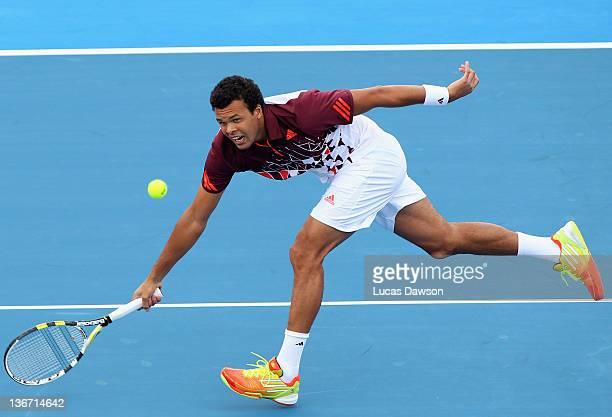 Jo-Wilfried Tsonga of France plays forehand during his match against Jurgen Melzer of Austria during day one of the AAMI Classic at Kooyong on...