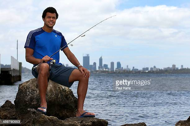 Jo-Wilfried Tsonga of France poses after fishing at the Applecross foreshore during a media call on day four of the Hopman Cup on December 31, 2013...