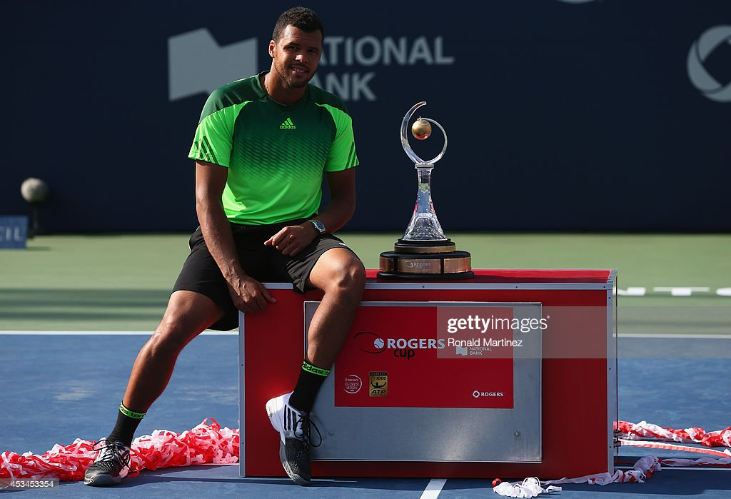 Jo-Wilfried Tsonga of France poses with the Rogers Cup trophy after his win against Roger Federer of Switzerland during Rogers Cup at Rexall Centre at York University on August 10, 2014 in Toronto, Canada.