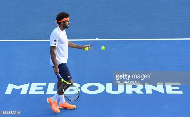 JoWilfried Tsonga of France prepares to serve against Thiago Monteiro of Brazil during their men's singles first round match on day one of the...
