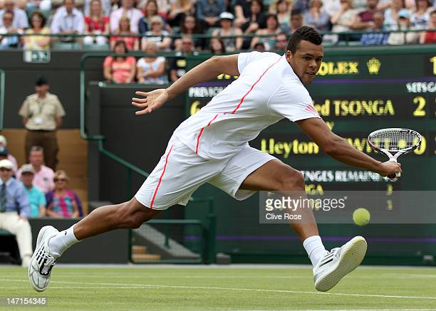 JoWilfried Tsonga of France reaches for a shot during his Gentlemen's Singles first round match against Lleyton Hewitt of Australia on day two of the...