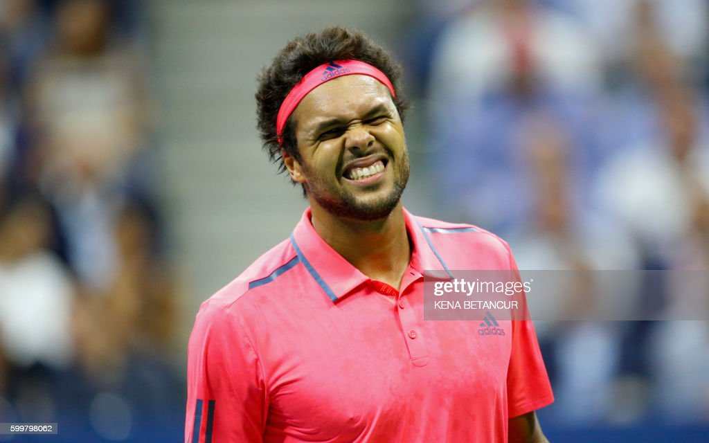TOPSHOT - Jo-Wilfried Tsonga of France reacts as he plays against Novak Djokovic of Serbia during their 2016 US Open Men's Singles match at the USTA Billie Jean King National Tennis Center in New York on September 6, 2016. /