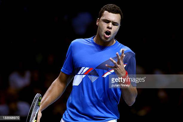 Jo-Wilfried Tsonga of France reacts during the men's singles first round match Roger Federer of Switzerland during the Barclays ATP World Tour Finals...