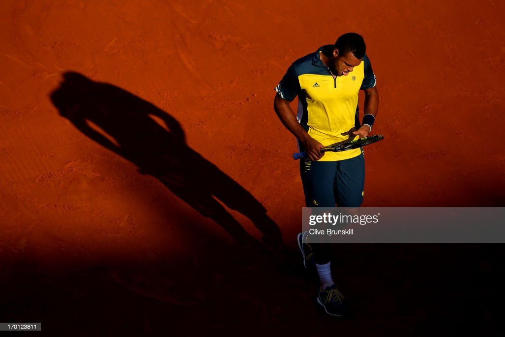 Jo-Wilfried Tsonga of France reacts during the men's singles semi-final match against David Ferrer of Spain on day thirteen of the French Open at Roland Garros on June 7, 2013 in Paris, France.