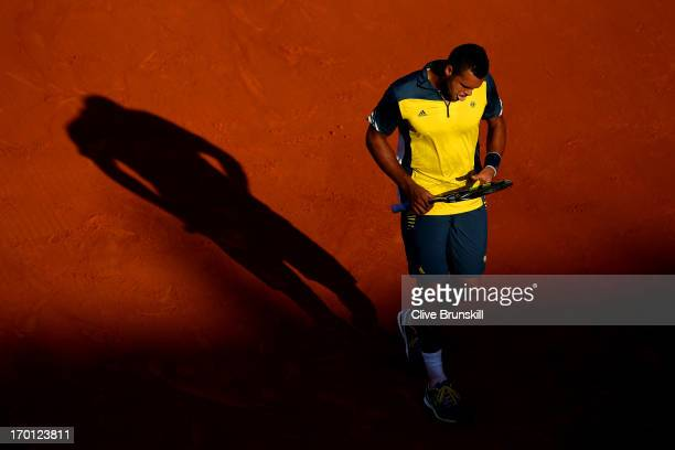 Jo-Wilfried Tsonga of France reacts during the men's singles semi-final match against David Ferrer of Spain on day thirteen of the French Open at...