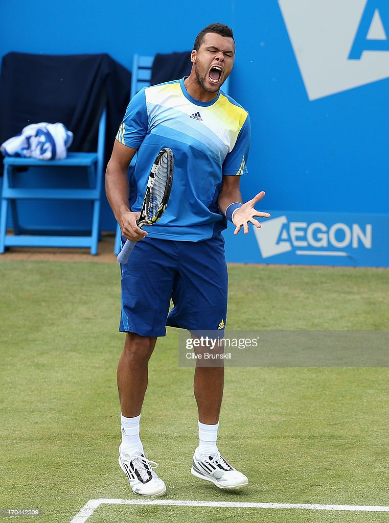 Jo-Wilfried Tsonga of France reacts during the Men's Singles third round match against Igor Sijsling of the Netherlands on day four of the AEGON Championships at Queens Club on June 13, 2013 in London, England.