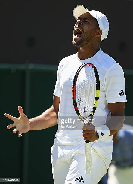 JoWilfried Tsonga of France reacts in his Gentlemen's Singles first round match against Gilles Muller of Luxembourg during day two of the Wimbledon...