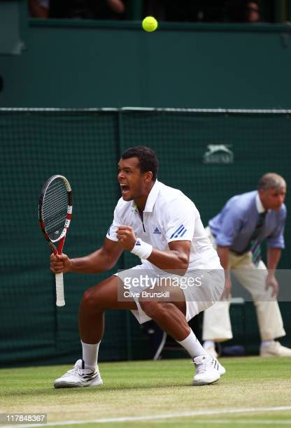 JoWilfried Tsonga of France reacts to a play during his semifinal round match against Novak Djokovic of Serbia on Day Eleven of the Wimbledon Lawn...