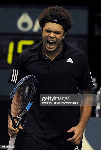 JoWilfried Tsonga of France reacts to Macro Chiudinelli of Switzerland during their quarterfinal round of ATP Thailand Open tennis tournament match...
