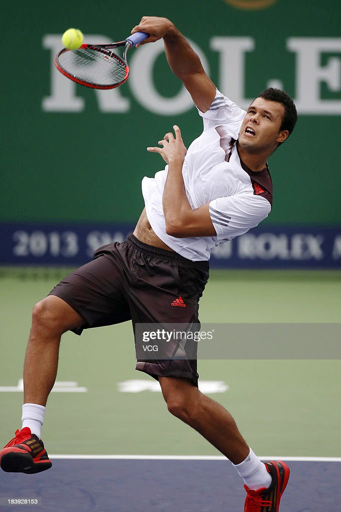 Jo-Wilfried Tsonga of France returns a ball to Pablo Andujar of Spain on day three of the Shanghai Rolex Masters at the Qi Zhong Tennis Center on October 9, 2013 in Shanghai, China.