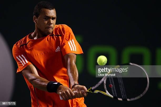 Jo-Wilfried Tsonga of France returns a shot against Rafael Nadal of Spain during day nine of the 2010 Sony Ericsson Open at Crandon Park Tennis...