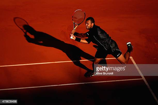 JoWilfried Tsonga of France returns a shot during his Men's quarter final match against Kei Nishikori of Japan on day of the 2015 French Open at...