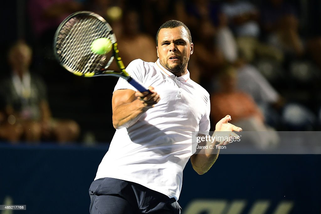 Jo-Wilfried Tsonga of France returns a shot from Denis Istomin of Uzbekistan during the second day of the Winston-Salem Open at Wake Forest University on August 25, 2015 in Winston-Salem, North Carolina.