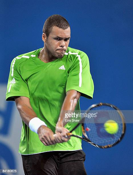 Jo-Wilfried Tsonga of France returns a shot to Agustin Calleri of Argentina during day three of the Brisbane International 2009 at the State Tennis...