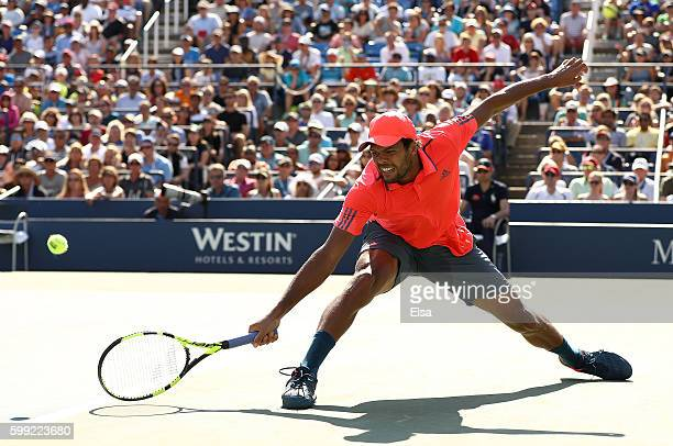 JoWilfried Tsonga of France returns a shot to Jack Sock of the United States during his fourth round Men's Singles match on Day Seven of the 2016 US...