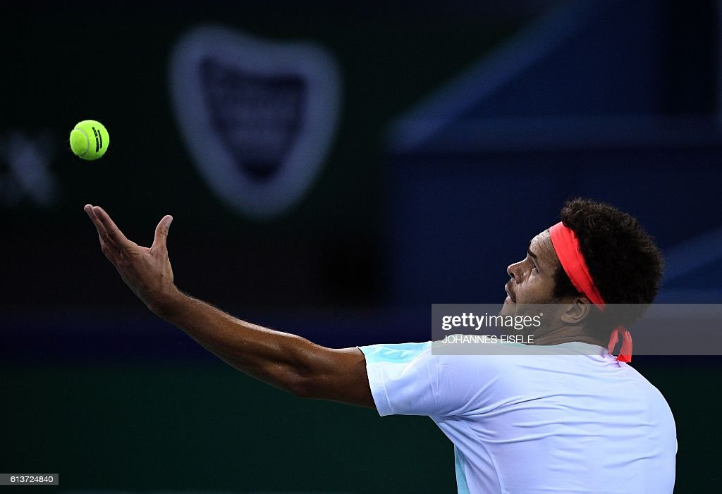 TOPSHOT - Jo-Wilfried Tsonga of France serves against Florian Mayer of Germany during their first round men's singles match at the Shanghai Masters tennis tournament in Shanghai on October 10, 2016. / AFP / JOHANNES