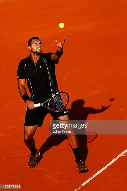 JoWilfried Tsonga of France serves during his Men's quarter final match against Kei Nishikori of Japan on day of the 2015 French Open at Roland...