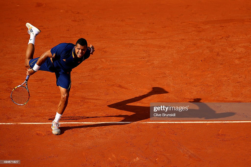 Jo-Wilfried Tsonga of France serves during his men's singles match against Jerzy Janowicz of Poland on day six of the French Open at Roland Garros on May 30, 2014 in Paris, France.