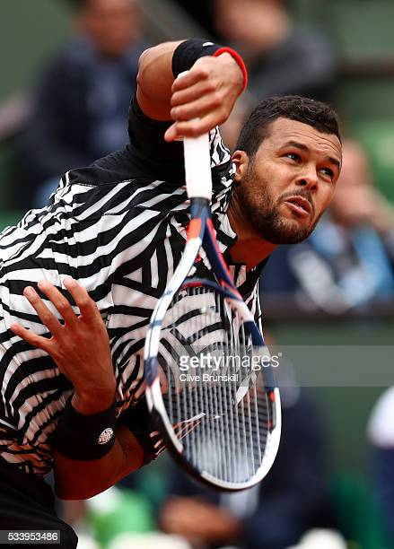 JoWilfried Tsonga of France serves during the Men's Singles first round match against JanLennard Struff of Germany on day three of the 2016 French...
