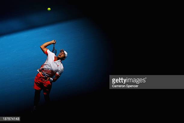 JoWilfried Tsonga of France serves in his fourth round match against Kei Nishikori of Japan during day eight of the 2012 Australian Open at Melbourne...