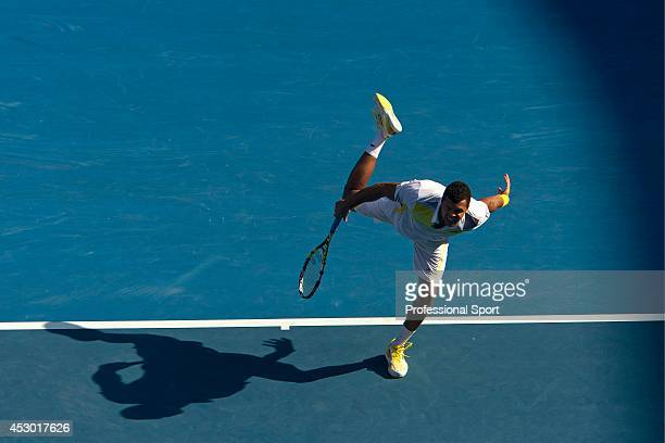 Jo-Wilfried Tsonga of France serves in his fourth round match against Richard Gasquet of France during day eight of the 2013 Australian Open at...
