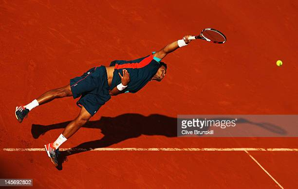 JoWilfried Tsonga of France serves in his men's singles fourth round match against Stanislas Wawrinka of Switzerland during day 8 of the French Open...