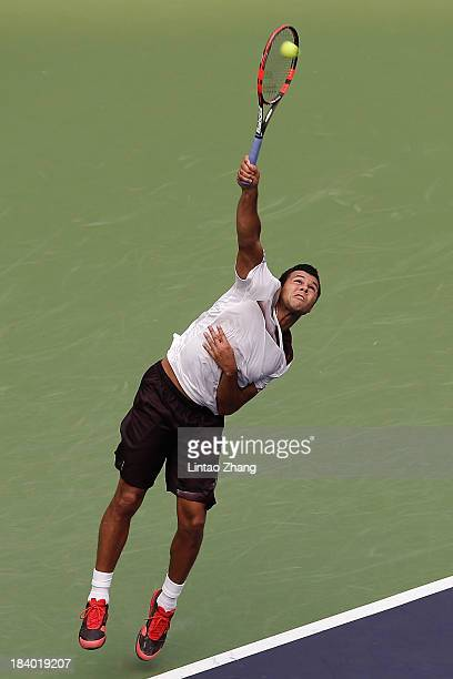 Jo-Wilfried Tsonga of France serves to Florian Mayer of Germany during day five of the Shanghai Rolex Masters at the Qi Zhong Tennis Center on...