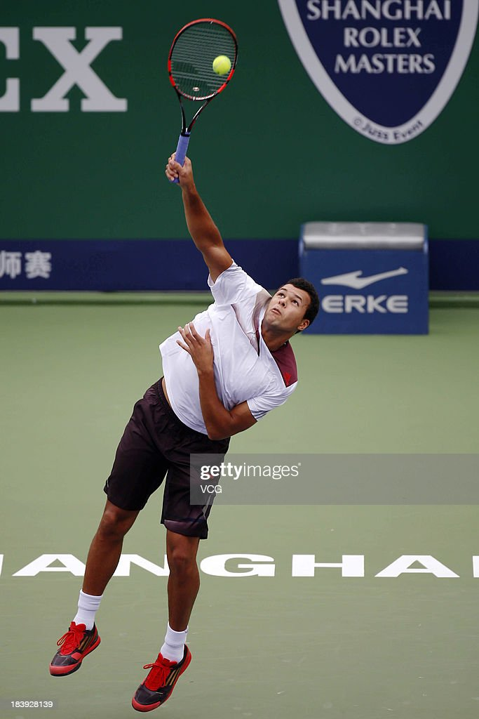Jo-Wilfried Tsonga of France serves to Pablo Andujar of Spain on day three of the Shanghai Rolex Masters at the Qi Zhong Tennis Center on October 9, 2013 in Shanghai, China.