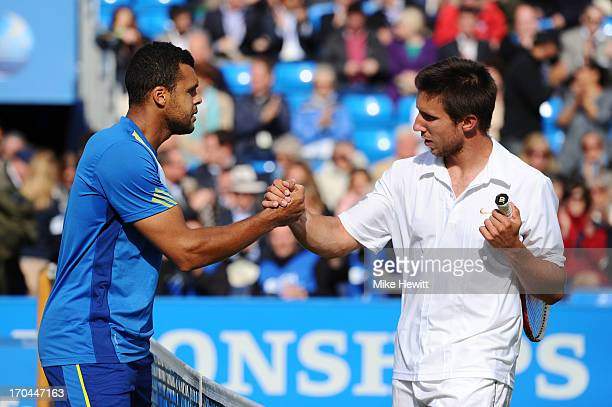 JoWilfried Tsonga of France shakes hands with Igor Sijsling of the Netherlands after victory during the Men's Singles third round match on day four...