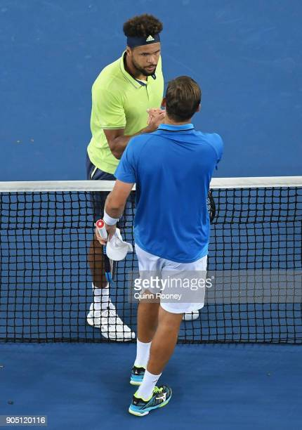 JoWilfried Tsonga of France shakes hands with Kevin King of the United States after winning their first round match on day one of the 2018 Australian...