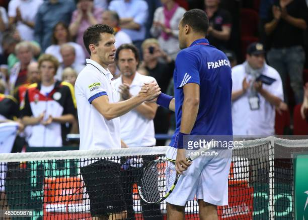 JoWilfried Tsonga of France shakes hands with Tobias Kamke of Germany after beating him during the second round Davis Cup match between France and...