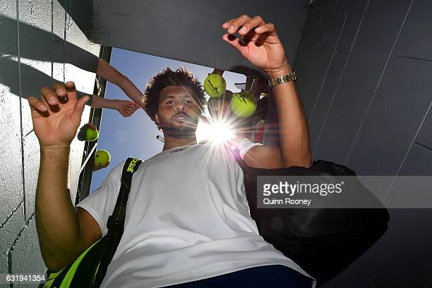 JoWilfried Tsonga of France signs autographs after winning his second round match against Dusan Lajovic of Serbia on day three of the 2017 Australian...