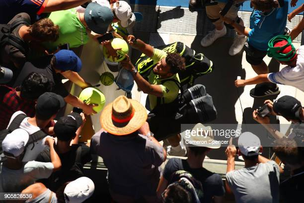 JoWilfried Tsonga of France signs autographs for fans after winning his second round match against Denis Shapovalov of Canada on day three of the...