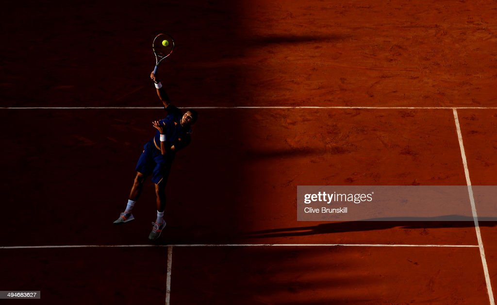 Jo-Wilfried Tsonga of France smashes the ball during his men's singles match against Jerzy Janowicz of Poland on day six of the French Open at Roland Garros on May 30, 2014 in Paris, France.