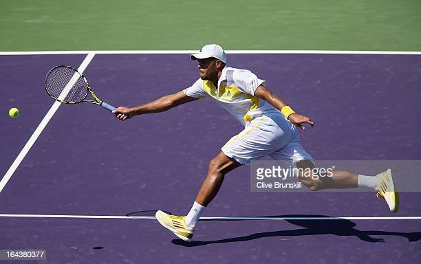 JoWilfried Tsonga of France stretches to play a volley against ViktorTroicki of Serbia during their second round match at the Sony Open at Crandon...