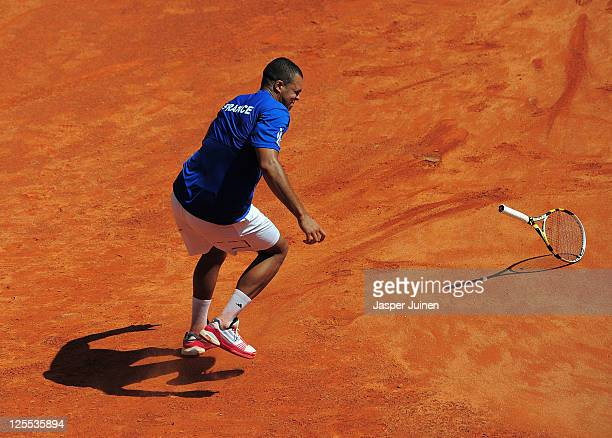 JoWilfried Tsonga of France throws his racket in his match against Rafael Nadal of Spain during the third and final day of the semi final Davis Cup...