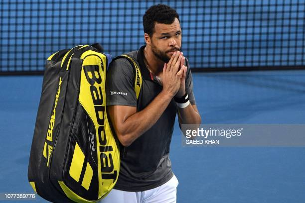 TOPSHOT JoWilfried Tsonga of France walks off the court after being defeated by Daniil Medvedev of Russia in the men's singles semifinal match at the...