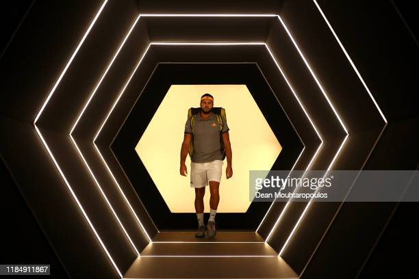 Jo-Wilfried Tsonga of France walks out to play in his match against Rafael Nadal of Spain on day 5 of the Rolex Paris Masters, part of the ATP World...
